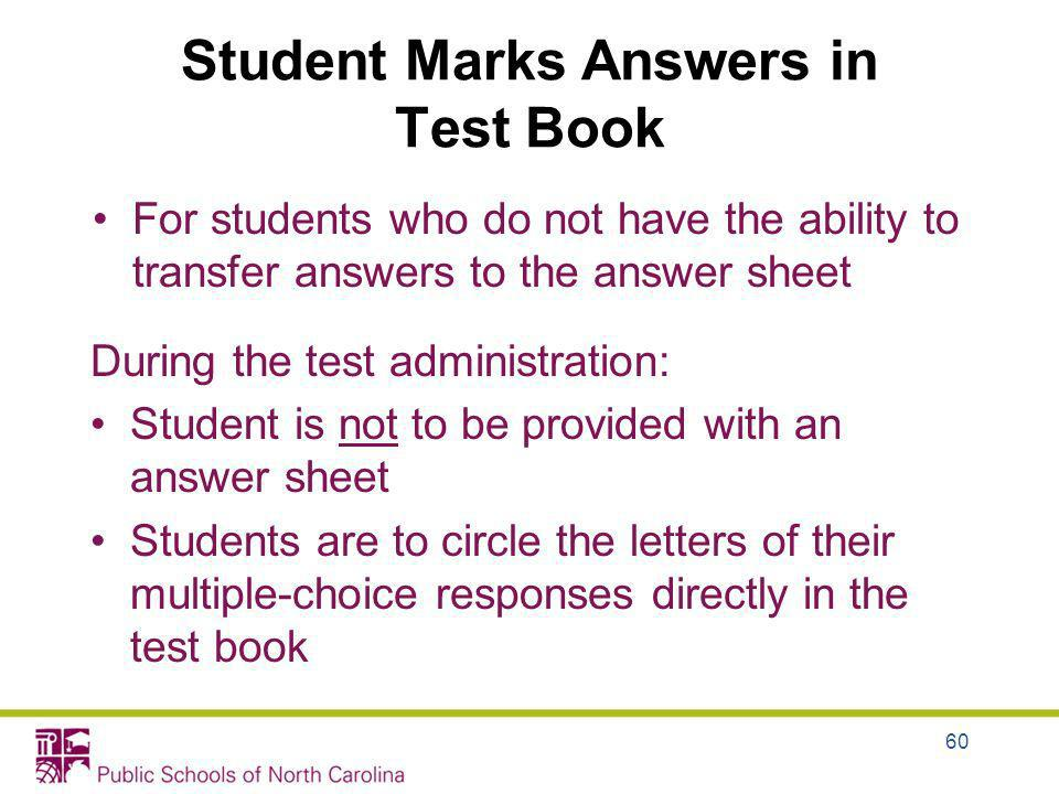 Student Marks Answers in Test Book