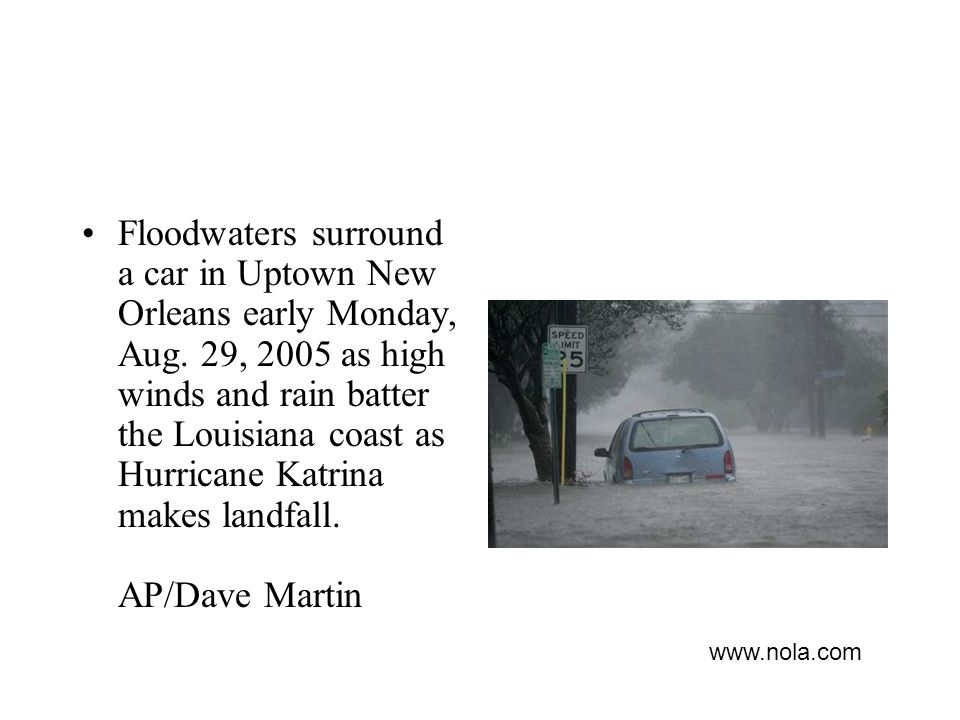 Floodwaters surround a car in Uptown New Orleans early Monday, Aug