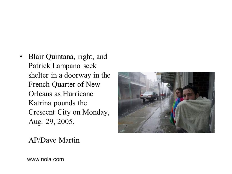 Blair Quintana, right, and Patrick Lampano seek shelter in a doorway in the French Quarter of New Orleans as Hurricane Katrina pounds the Crescent City on Monday, Aug. 29, 2005. AP/Dave Martin