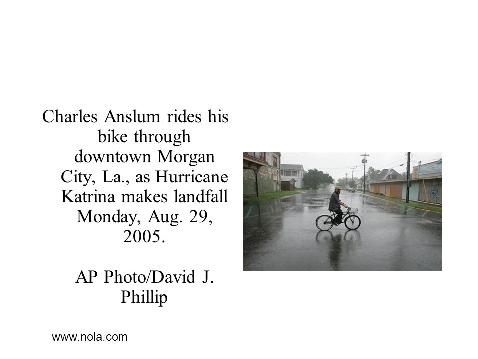 Charles Anslum rides his bike through downtown Morgan City, La