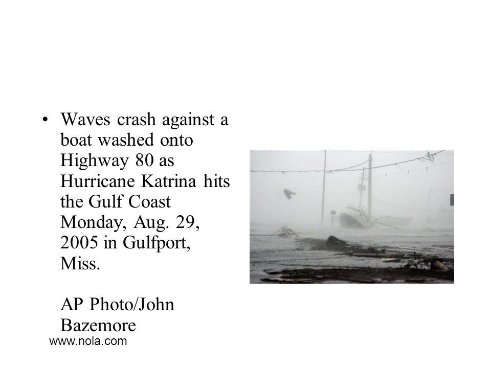 Waves crash against a boat washed onto Highway 80 as Hurricane Katrina hits the Gulf Coast Monday, Aug. 29, 2005 in Gulfport, Miss. AP Photo/John Bazemore