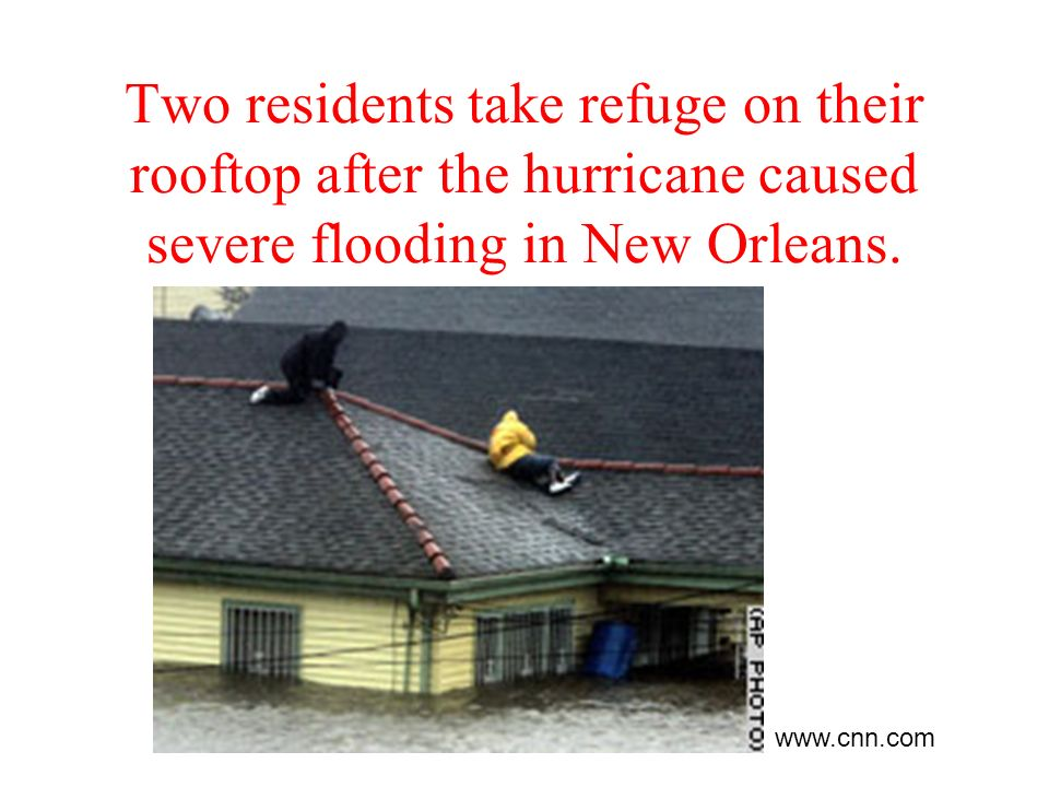 Two residents take refuge on their rooftop after the hurricane caused severe flooding in New Orleans.