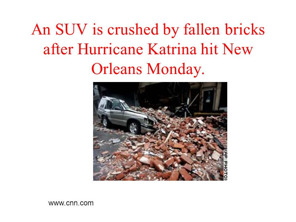 An SUV is crushed by fallen bricks after Hurricane Katrina hit New Orleans Monday.