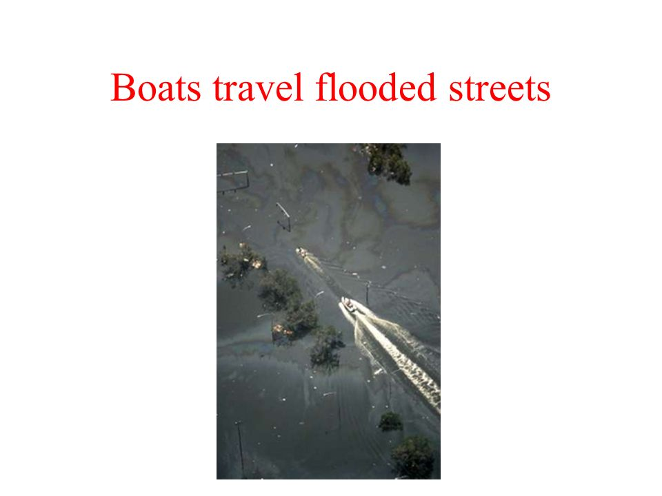 Boats travel flooded streets