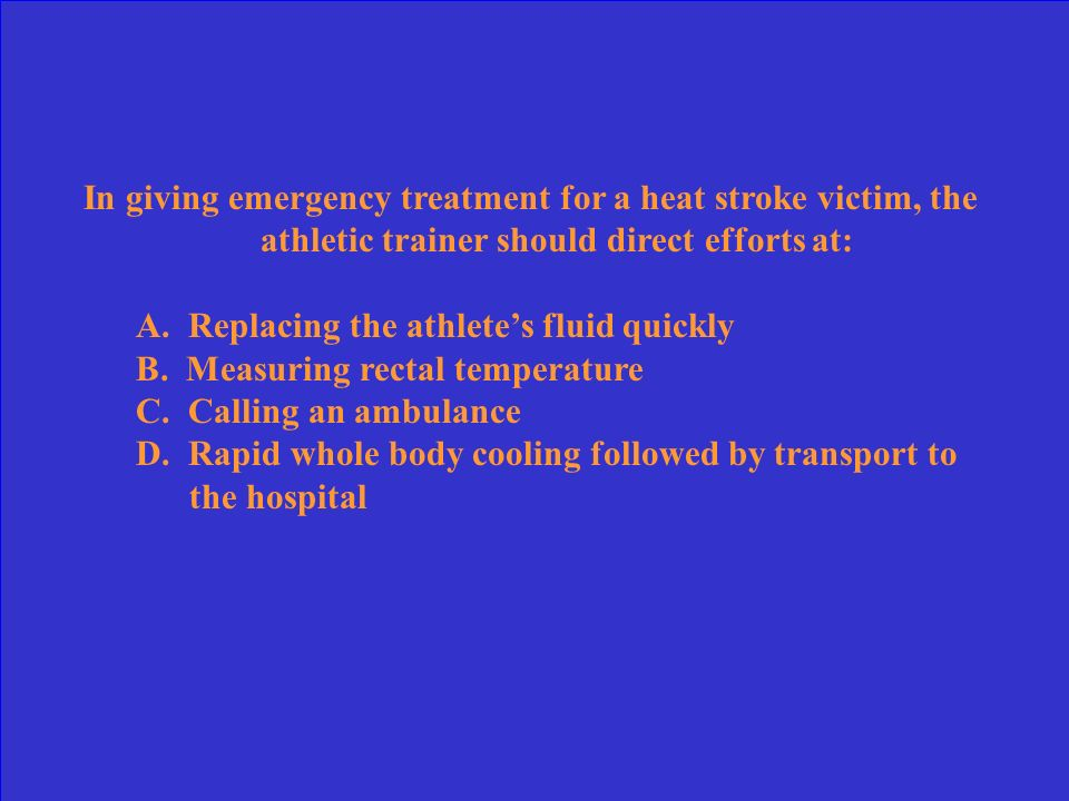 In giving emergency treatment for a heat stroke victim, the athletic trainer should direct efforts at:
