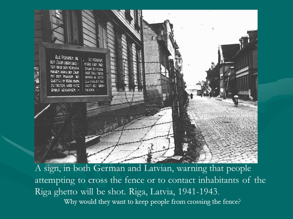 A sign, in both German and Latvian, warning that people attempting to cross the fence or to contact inhabitants of the Riga ghetto will be shot. Riga, Latvia, 1941-1943.
