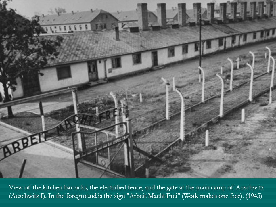 View of the kitchen barracks, the electrified fence, and the gate at the main camp of Auschwitz (Auschwitz I).