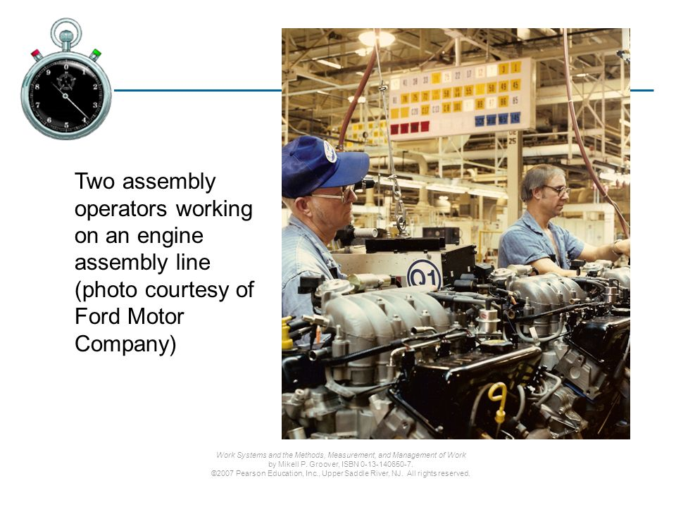 Two assembly operators working on an engine assembly line (photo courtesy of Ford Motor Company