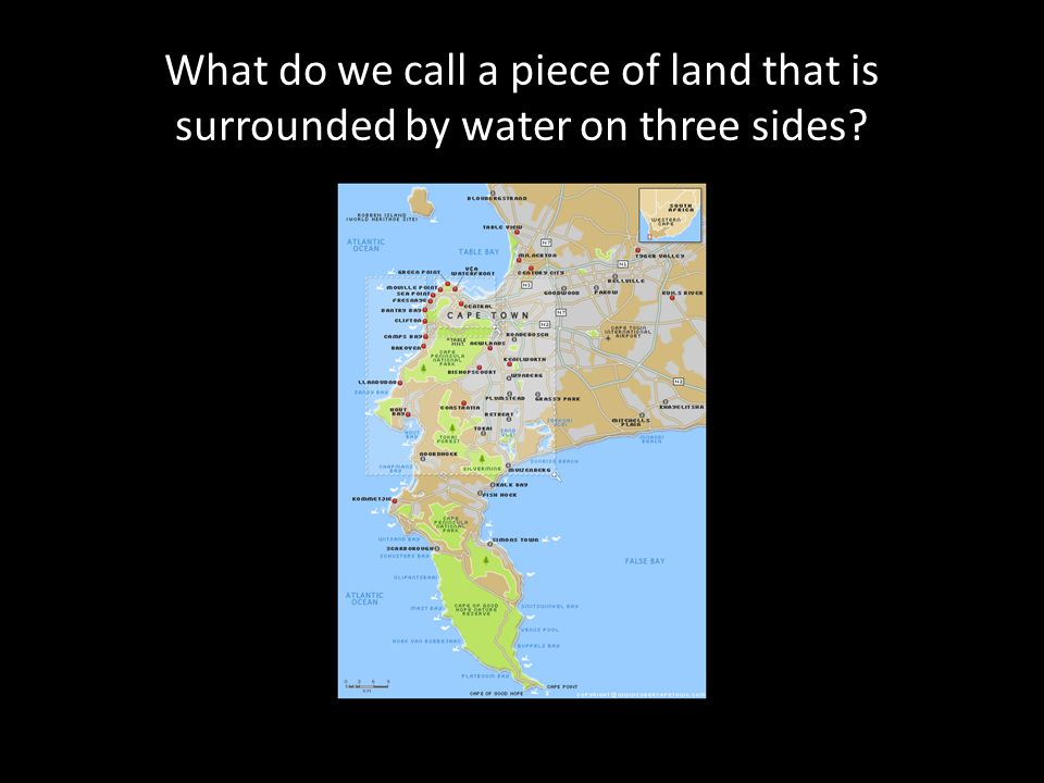 What do we call a piece of land that is surrounded by water on three sides