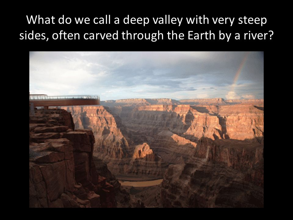What do we call a deep valley with very steep sides, often carved through the Earth by a river