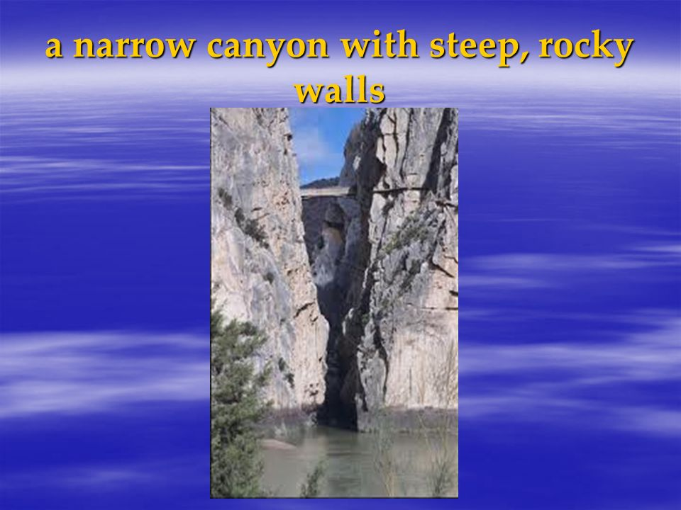 a narrow canyon with steep, rocky walls