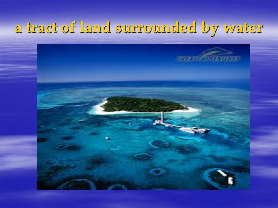 a tract of land surrounded by water