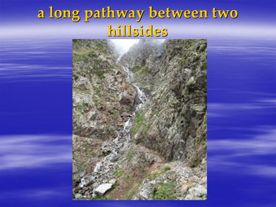 a long pathway between two hillsides