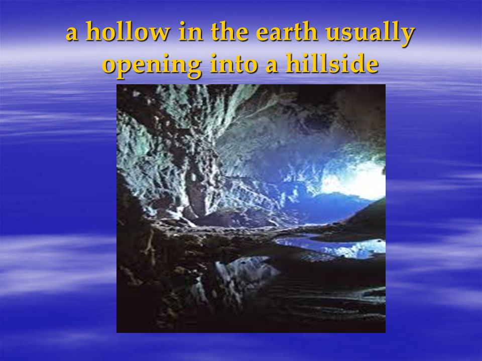 a hollow in the earth usually opening into a hillside