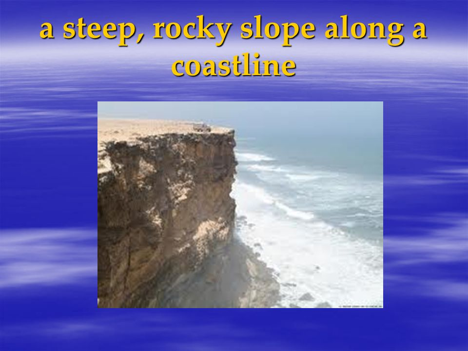 a steep, rocky slope along a coastline