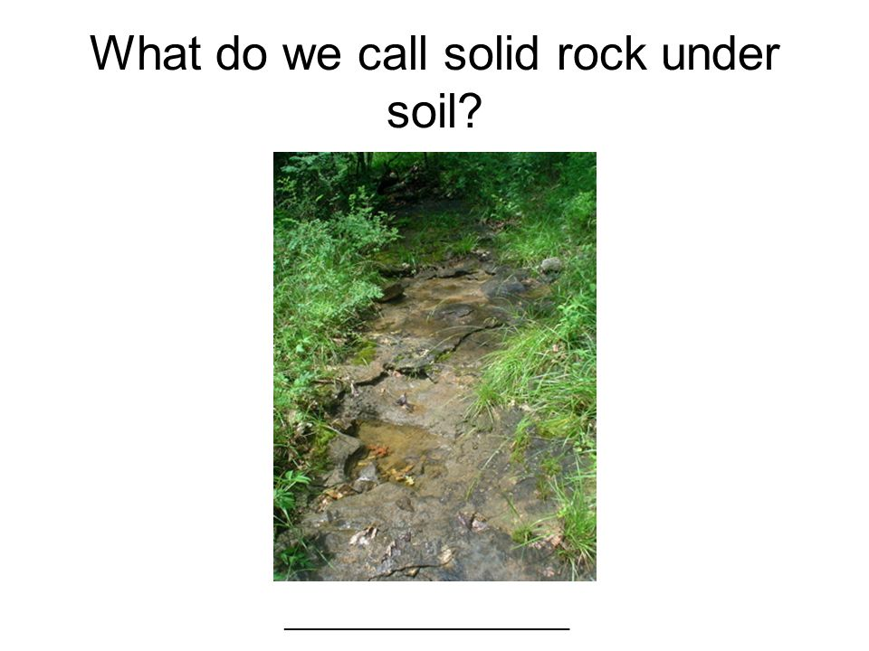 What do we call solid rock under soil