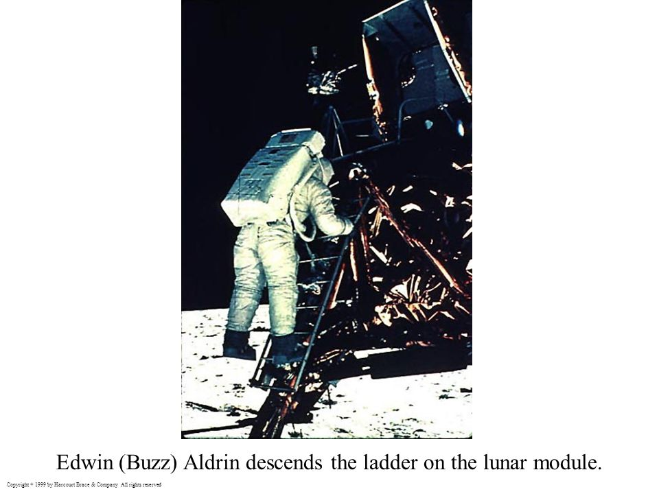 Edwin (Buzz) Aldrin descends the ladder on the lunar module.