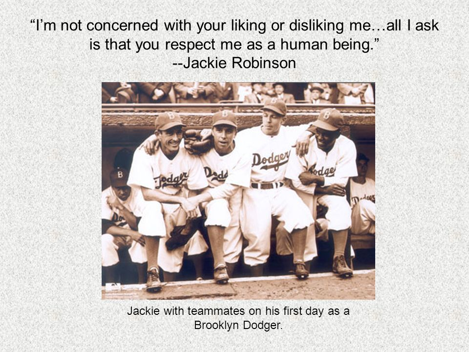 Jackie with teammates on his first day as a Brooklyn Dodger.
