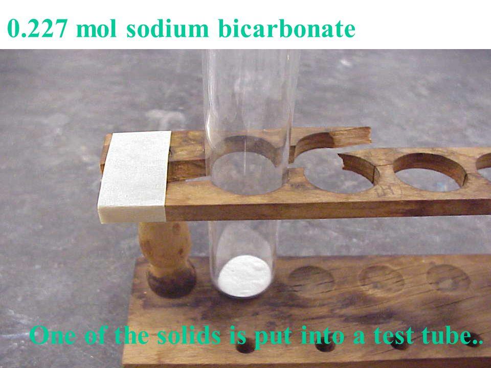 0.227 mol sodium bicarbonate