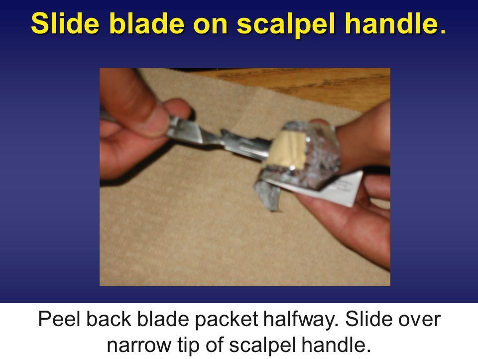 Slide blade on scalpel handle.