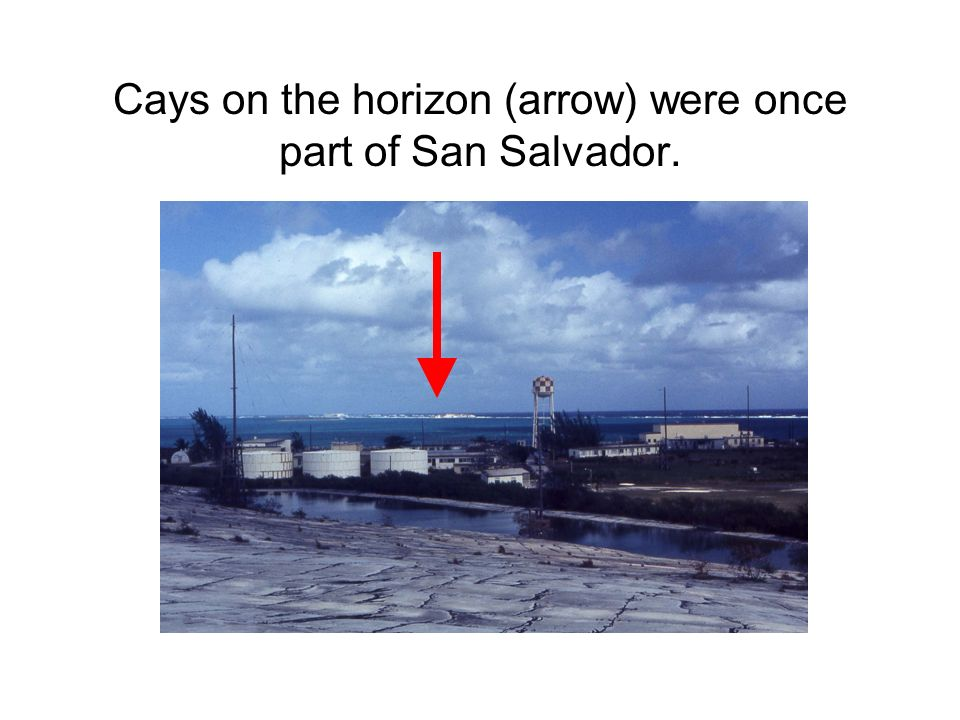 Cays on the horizon (arrow) were once part of San Salvador.