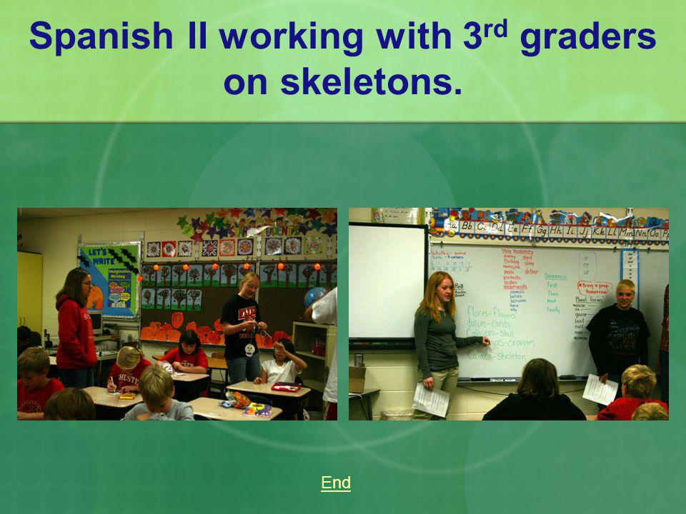Spanish II working with 3rd graders on skeletons.