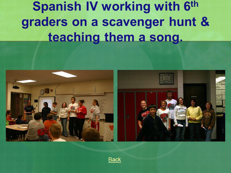 Spanish IV working with 6th graders on a scavenger hunt & teaching them a song.
