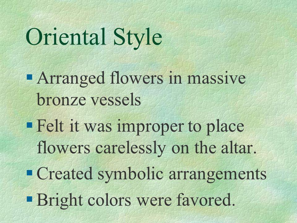 Oriental Style Arranged flowers in massive bronze vessels