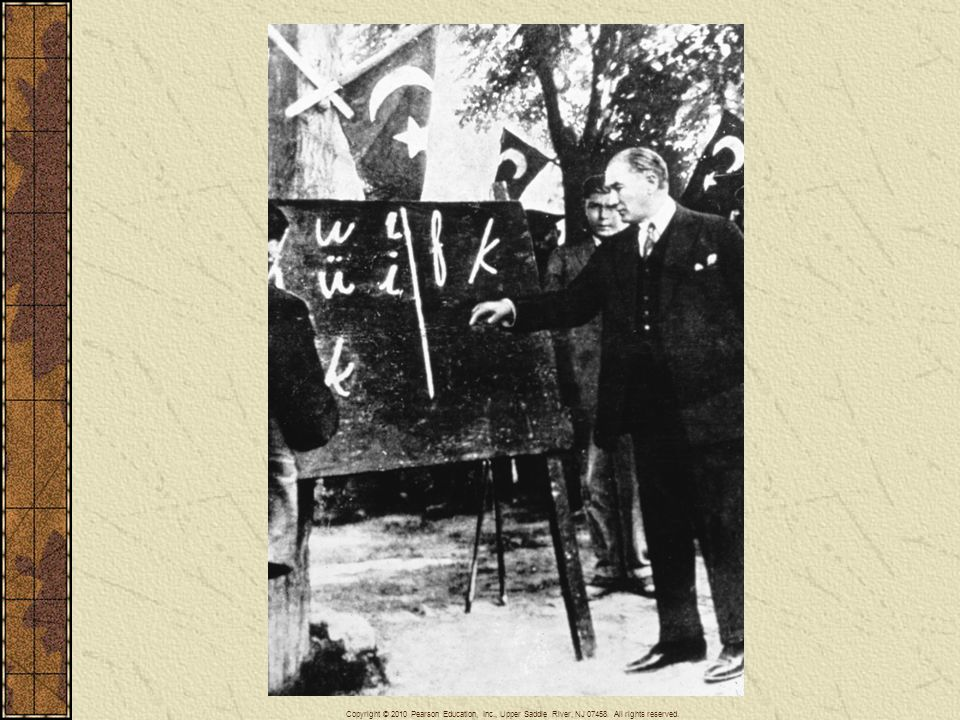 Ataturk (1881–1938), the father of the Turkish Republic, sought to modernize his country by forcing Turks to adopt western ways, including the Latin alphabet. Here he is shown teaching the alphabet as president in 1928.