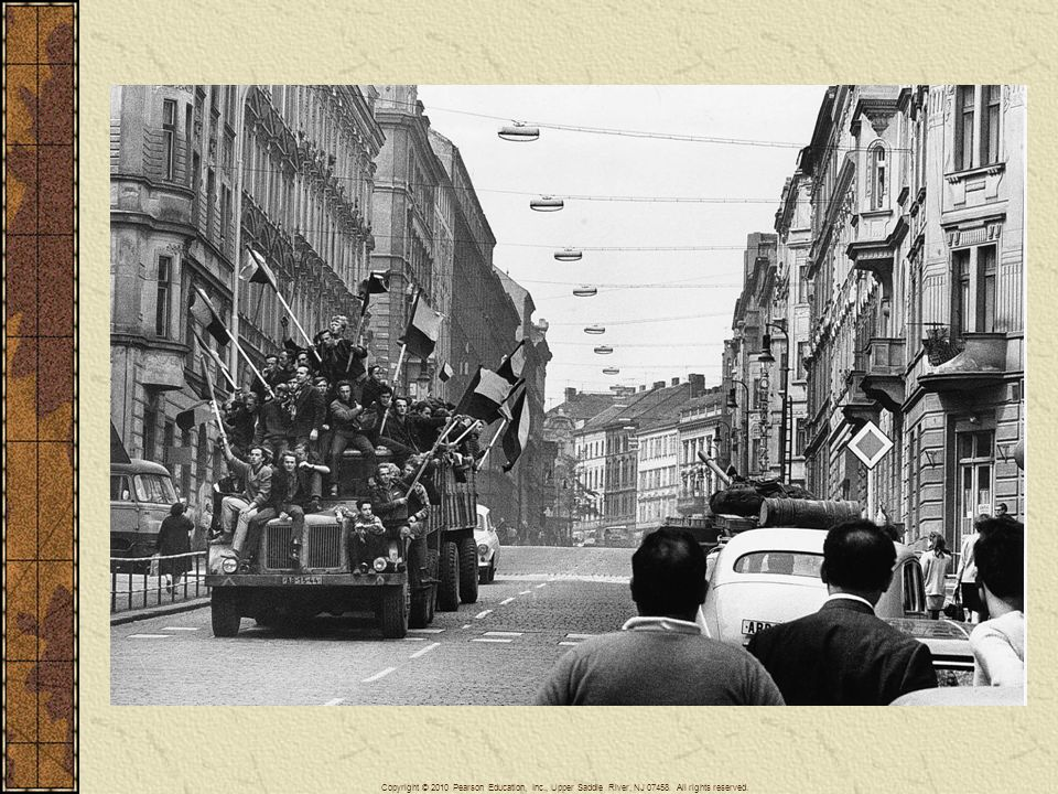 In the summer of 1968, Soviet tanks rolled into Czechoslovakia, ending that country's experiment in liberalized communism. This picture shows defiant flag-waving Czechs on a truck rolling past a Soviet tank in the immediate aftermath of the invasion.