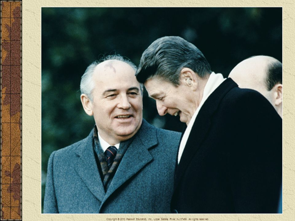 President Ronald Reagan and Premier Mikhail Gorbachev confer at a summit meeting in December 1989.