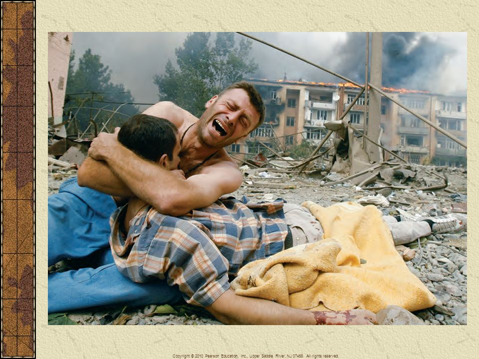 The aftermath of an attack by a Russian warplane on an apartment block in Gori, Georgia, during the conflict in South Ossetia in August 2008. Here a Georgian man cradles the body of a relative killed during the bombing, which killed at least five people.