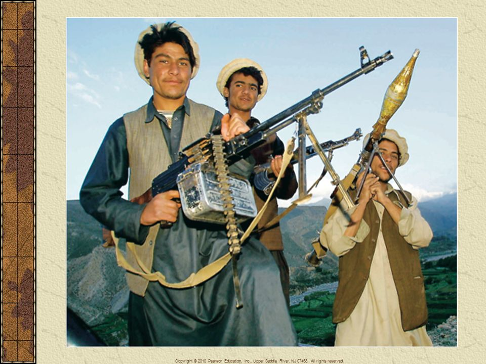 Taliban fighters brandish machine-guns and rocket launchers near the Tora Bora mountains in Afghanistan, the site of a major battle with U.S. forces in late 2001.