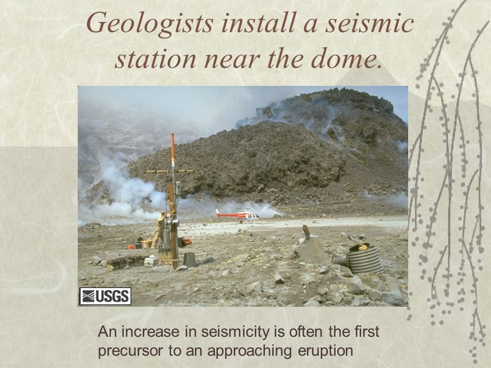 Geologists install a seismic station near the dome.