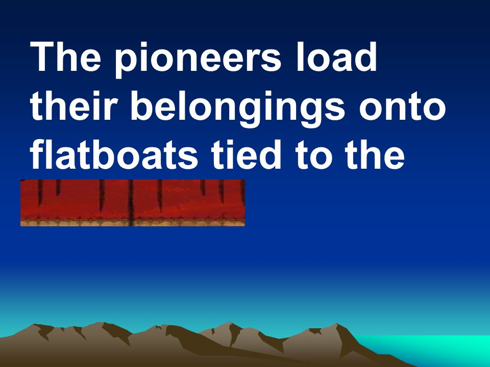 The pioneers load their belongings onto flatboats tied to the docks.