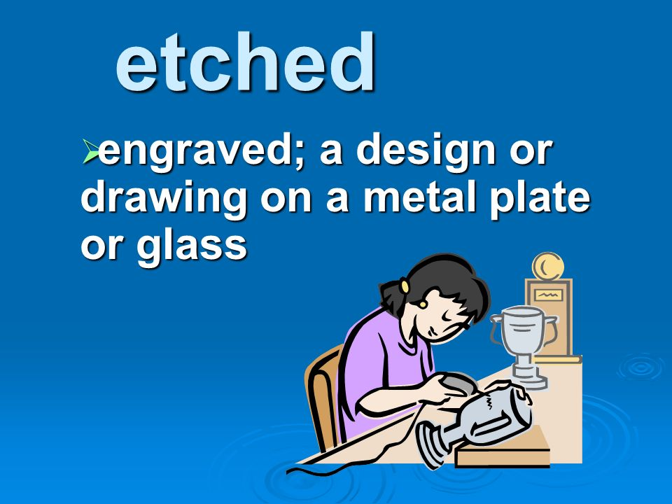 engraved; a design or drawing on a metal plate or glass