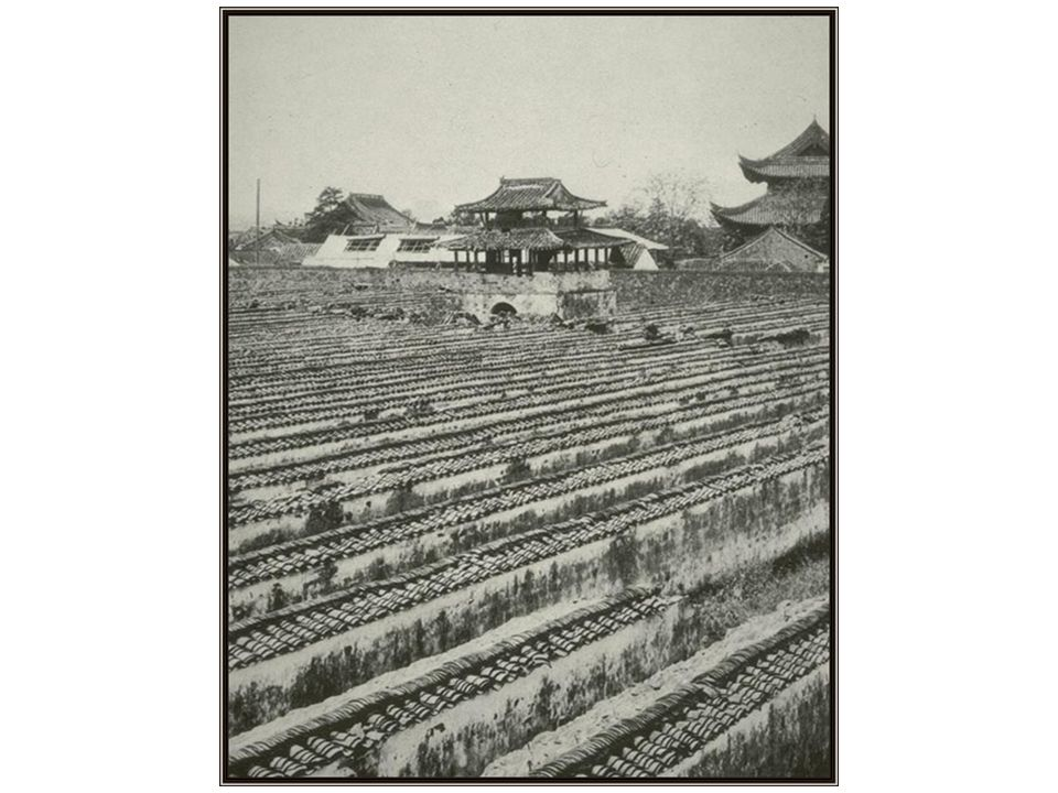 China, turn of the century, testing stalls. You see the roof tiles