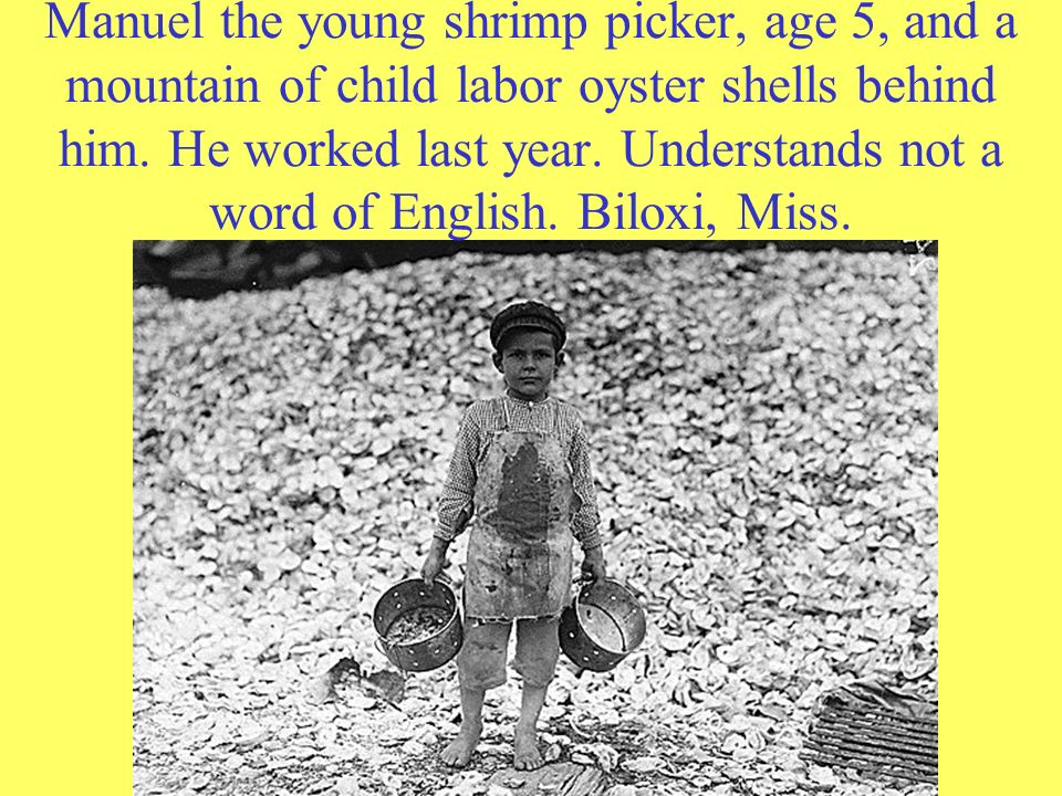 Manuel the young shrimp picker, age 5, and a mountain of child labor oyster shells behind him.