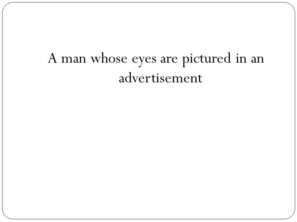 A man whose eyes are pictured in an advertisement
