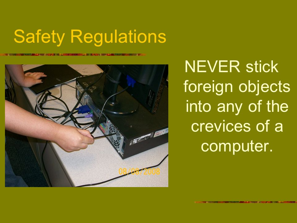 NEVER stick foreign objects into any of the crevices of a computer.