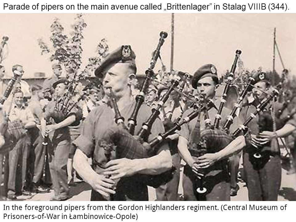 "Parade of pipers on the main avenue called ""Brittenlager in Stalag VIIIB (344)."