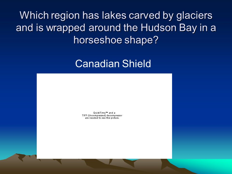 Which region has lakes carved by glaciers and is wrapped around the Hudson Bay in a horseshoe shape