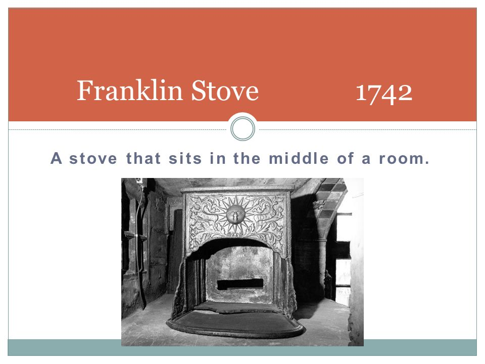 A stove that sits in the middle of a room.