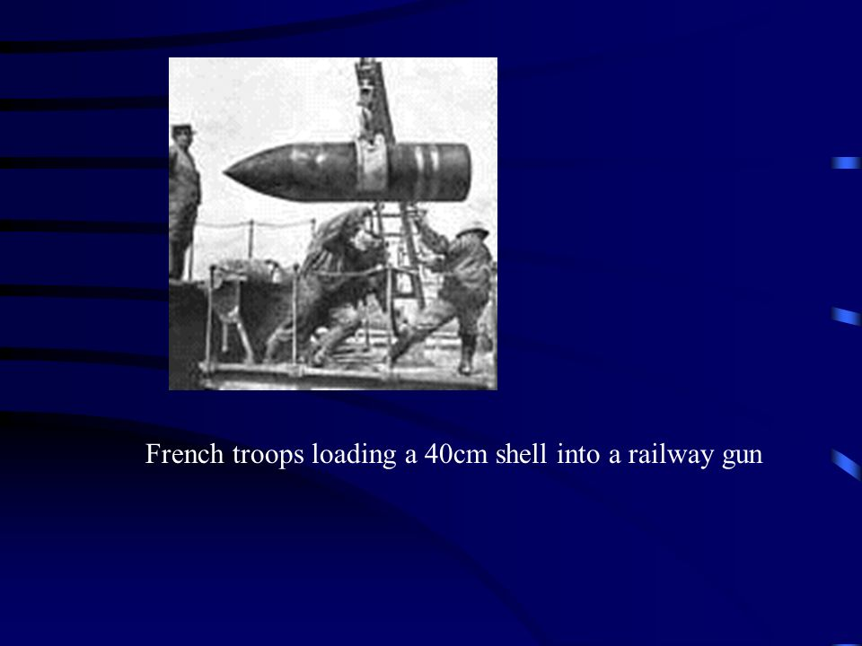 French troops loading a 40cm shell into a railway gun