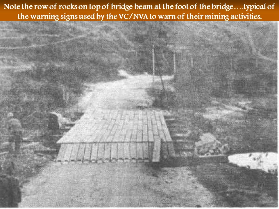 Note the row of rocks on top of bridge beam at the foot of the bridge…