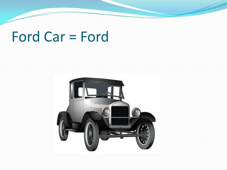 Ford Car = Ford There is a cart on top of the Ford.