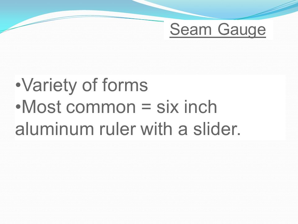 Most common = six inch aluminum ruler with a slider.