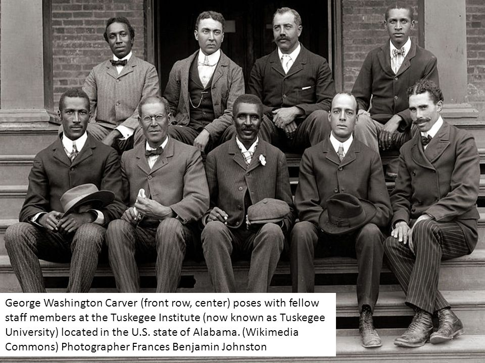 George Washington Carver (front row, center) poses with fellow staff members at the Tuskegee Institute (now known as Tuskegee University) located in the U.S.