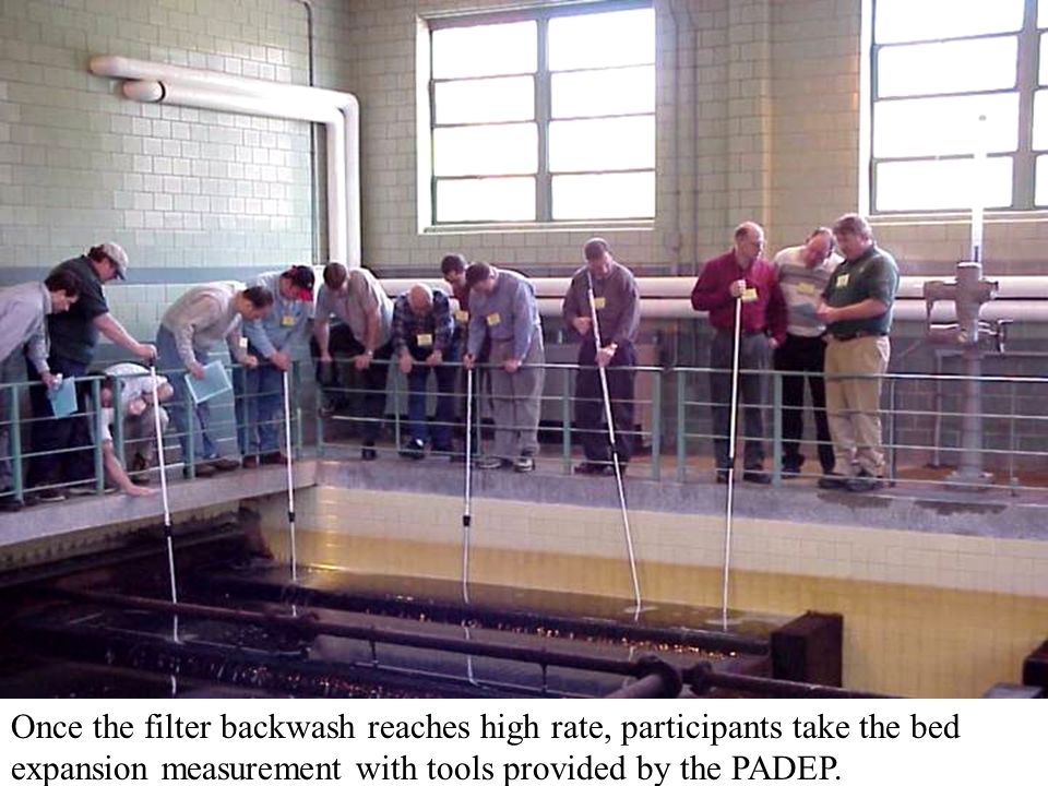 Once the filter backwash reaches high rate, participants take the bed expansion measurement with tools provided by the PADEP.