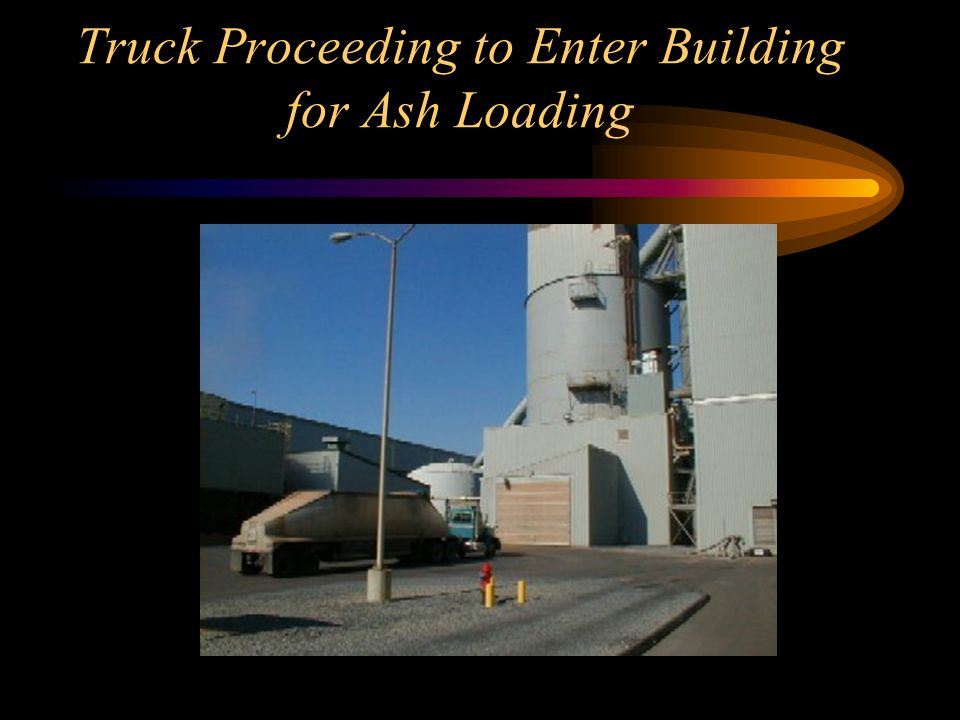 Truck Proceeding to Enter Building for Ash Loading